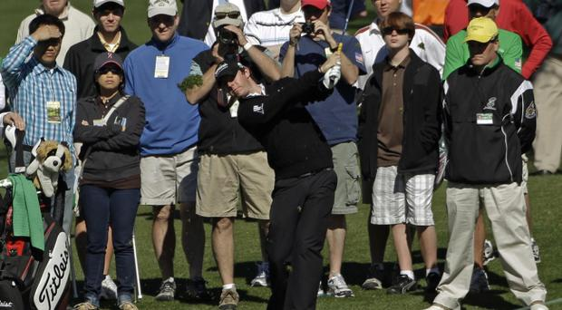 Rory McIlroy tees off on the second fairway during a practice round for the Masters golf tournament Wednesday, April 6, 2011, in Augusta