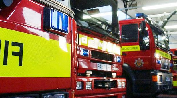 Around 40 firefighters are tackling a blaze at a warehouse in Enfield, north London