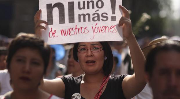 People march during a protest against violence in Mexico City after a continuing tide of drug-related killings (AP)