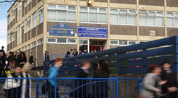 Teachers at Darwen Vale High School in Lancashire are striking in protest over claims of violence and threats from pupils
