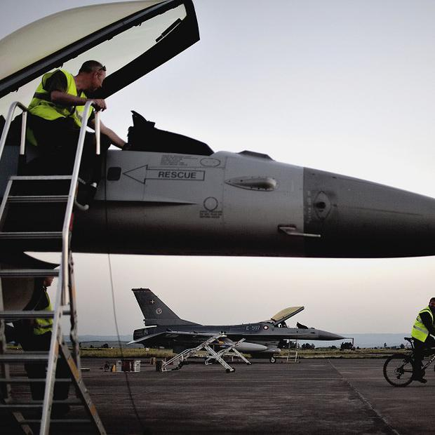 A Nato jet is prepared for air strikes against government targets in Libya (AP)