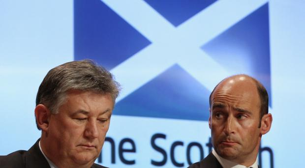 EDINBURGH, SCOTLAND - MARCH 08: Peter Lawell chief executive of Celtic and Martin Bain chief executive of Rangers attend a media briefing at St Andrews house on March 8, 2011 in Edinburgh, Scotland. The summit was called to discuss tackling violence surrounding Old Firm football matches and was chaired by First Minister Alex Salmond, representatives from the SFA, the police, Rangers and Celtic. (Photo by Jeff J Mitchell/Getty Images)
