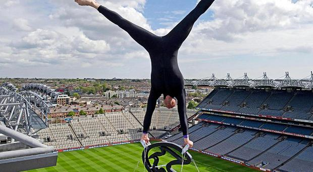 Balancing artist Eskil Ronningsbakken performing at the top of Croke Park in Dublin, where the Queen is to visit next month
