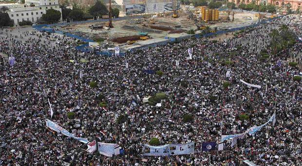 Thousands of Egyptians protest in Cairo, demanding the prosecution of ousted president Hosni Mubarak and his regime (AP)