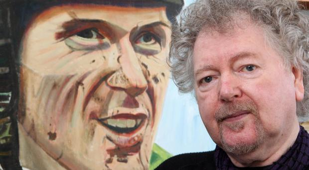 Artist Alan Quigley with his painting of Tony McCoy