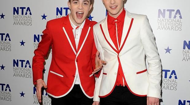 Jedward - John and Edward Grimes - are considering getting rid of their famous quiffs for charity