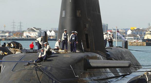 A Navy employee has been arrested after two people were shot, one fatally, on submarine HMS Astute