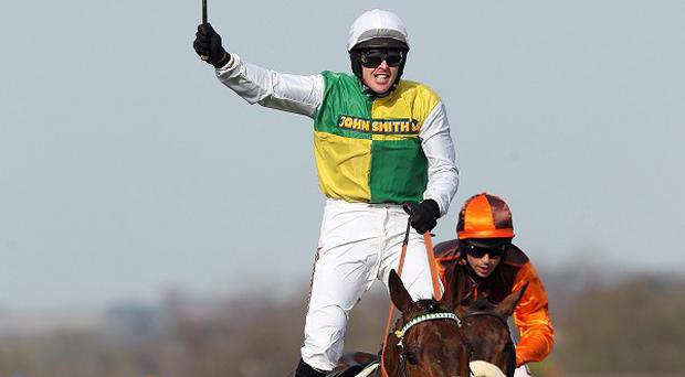Ballabriggs, ridden by Jason Maguire, wins the John Smith's Grand National Steeple Chase at Aintree