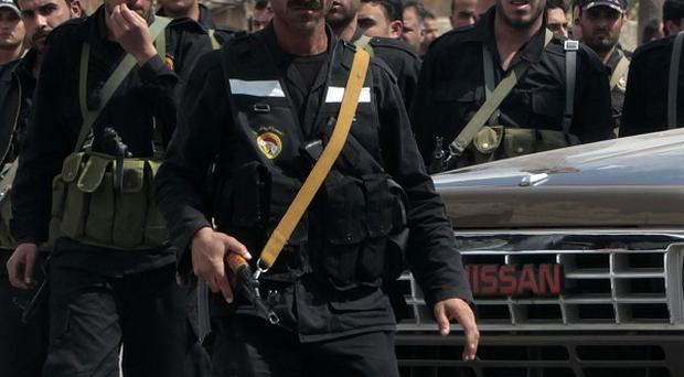 Syrian intelligence security forces patrol in the southern city of Daraa as more protests are held (AP)
