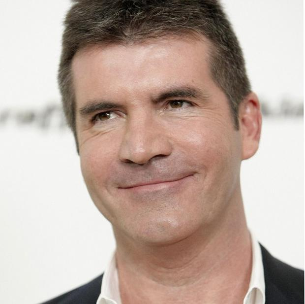 Simon Cowell said the Black Eyed Pea's Fergie had come up in discussions about a possible judge for the X Factor in the US