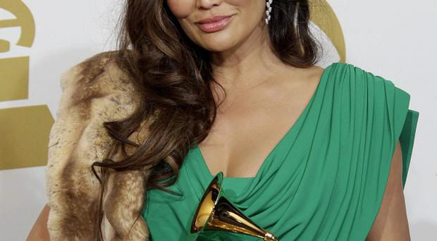 Tia Carrere cannot win any more Hawaiian music Grammys as the category has been abolished (AP Photo/Jae C. Hong, file)