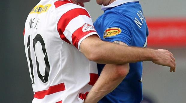 Hamilton's Alex Neil squares up to Rangers Steven Naismith during yesterday's encounter at New Douglas Park