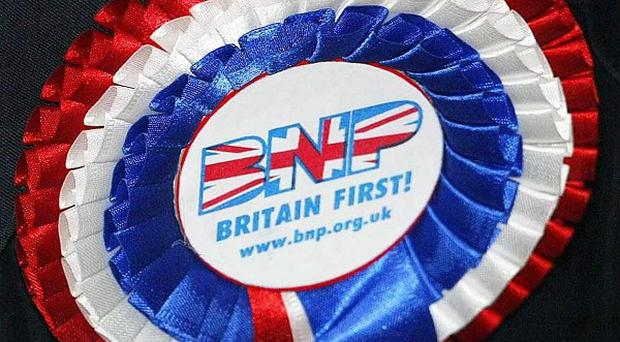 A BNP candidate for the Welsh Assembly elections has been charged with burning a Koran