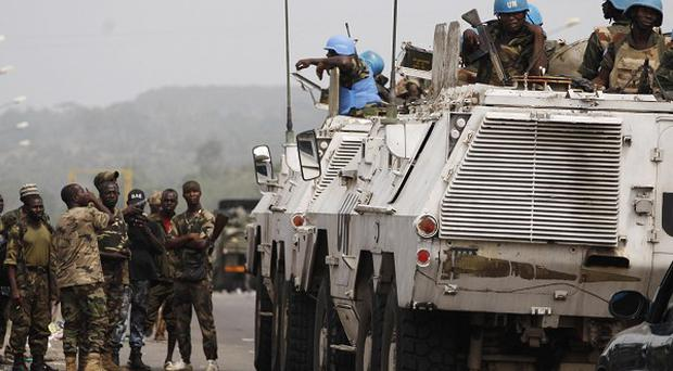 United Nations soldiers talk to forces loyal to Alassane Ouattara in Abidjan, Ivory Coast (AP)