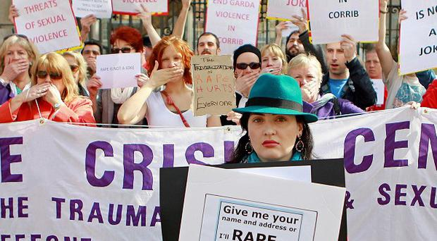 Women from groups including the Dublin Rape Crisis Centre gather outside Leinster House to protest