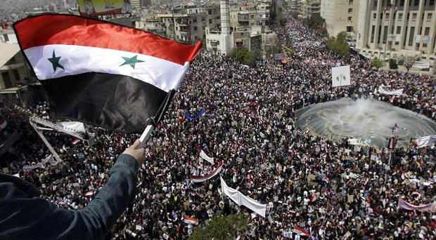 Security forces have surrounded a port city in Syria where protesters are gathering for another day of demonstrations (AP)