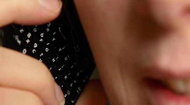 British mobile phone users are wasting an average of 195 pounds a year on their mobile phone bills, a report found
