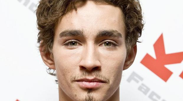 Robert Sheehan stars in the new comedy film Killing Bono