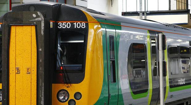 A woman passenger has died after a fire broke out in the toilet of a London-bound commuter train