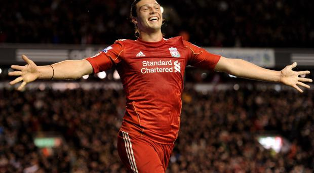 LIVERPOOL, ENGLAND - APRIL 11: Andy Carroll of Liverpool celebrates scoring his team's third goal during the Barclays Premier League match between Liverpool and Manchester City at Anfield on April 11, 2011 in Liverpool, England. (Photo by Michael Regan/Getty Images)