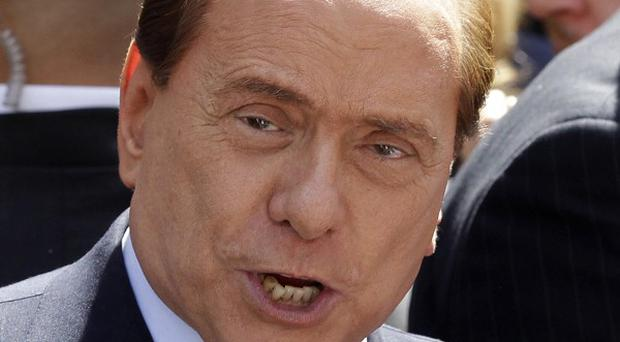 Italian premier Silvio Berlusconi outside Milan's court where he attended his trial on tax fraud charges (AP/Luca Bruno)