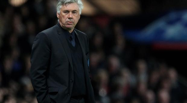 MANCHESTER, ENGLAND - APRIL 12: Chelsea Manager Carlo Ancelotti looks on during the UEFA Champions League Quarter Final second leg match between Manchester United and Chelsea at Old Trafford on April 12, 2011 in Manchester, United Kingdom. (Photo by Alex Livesey/Getty Images)