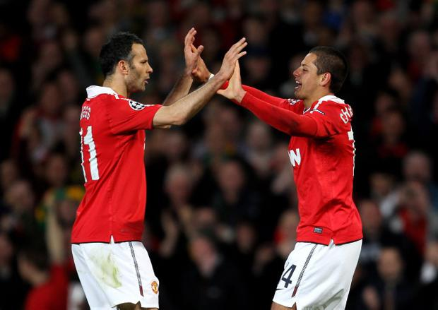 MANCHESTER, ENGLAND - APRIL 12: Javier Hernandez of Manchester United celebrates scoring the opening goal with team mate Ryan Giggs (L) during the UEFA Champions League Quarter Final second leg match between Manchester United and Chelsea at Old Trafford on April 12, 2011 in Manchester, England. (Photo by Alex Livesey/Getty Images)