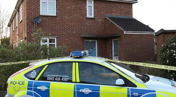 Police outside a flat in Mill Close, Norwich, where a woman and two children were stabbed