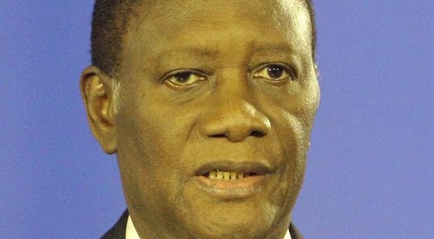 Ivory Coast president Alassane Ouattara has called on citizens to lay down their arms (AP)