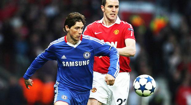 Manchester United's John O'Shea (right) and Chelsea's Fernando Torres battle for the ball during the UEFA Champions League, Quarter Final, Second Leg at Old Trafford, Manchester. Torres was again well short of his best.