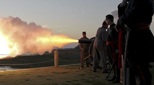 Reenactors fire mortars from the Pitt Street Bridge towards Fort Sumter (AP)
