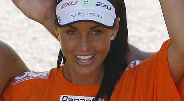 Katie Price, pictured finishing the London Marathon in 2009, has pulled out of this year's race