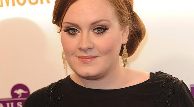 Adele is still at the top of the album chart with 21