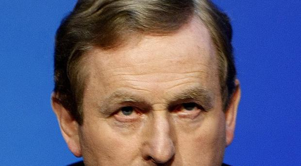 Taoiseach Enda Kenny said the IMF was on Ireland's side over the cost of the 85 billion euro bailout loan