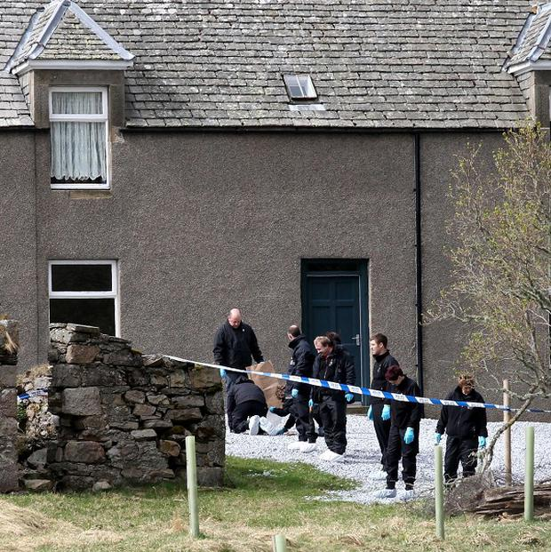 Police at the scene where two teenagers were found shot dead