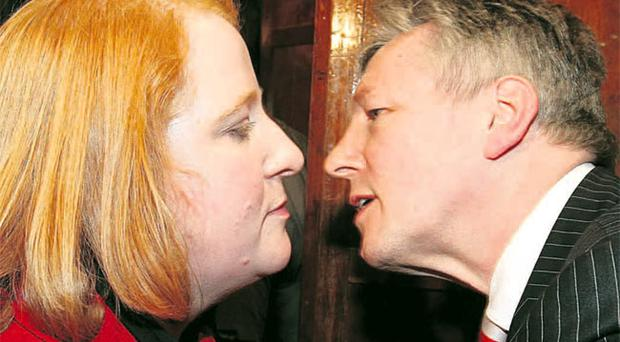 Peter Robinson congratulates Naomi Long after her upset at the polls last year