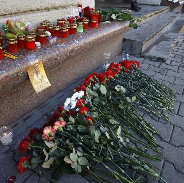 Tributes to blast victims left outside Oktyabrskaya station in Minsk (AP)
