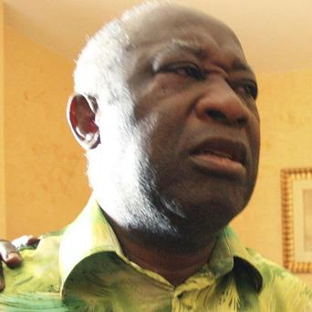 Laurent Gbagbo will go on trial facing charges on a 'national and international' level (AP/Aristide Bodegla)