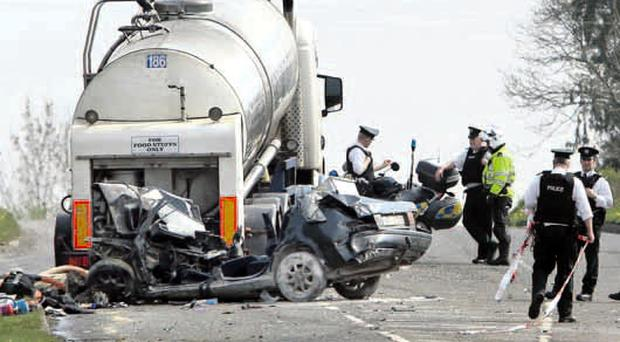 The aftermath of the accident involving a car and a milk tanker