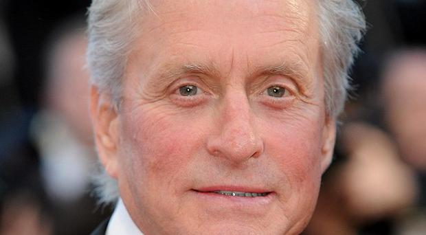 Michael Douglas and his ex-wife are locked in a court battle over his Wall Street: Money Never Sleeps earnings