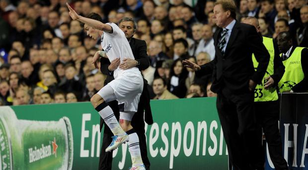 LONDON, ENGLAND - APRIL 13: Real Madrid manager Jose Mourinho grabs Gareth Bale of Spurs as he falls during the UEFA Champions League quarter final second leg match between Tottenham Hotspur and Real Madrid at White Hart Lane on April 13, 2011 in London, England. (Photo by Jasper Juinen/Getty Images)