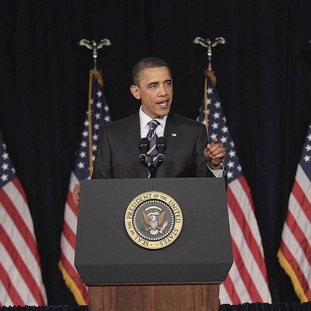 President Barack Obama has unveiled a politically risky plan to reduce the US deficit by four trillion dollars (AP)