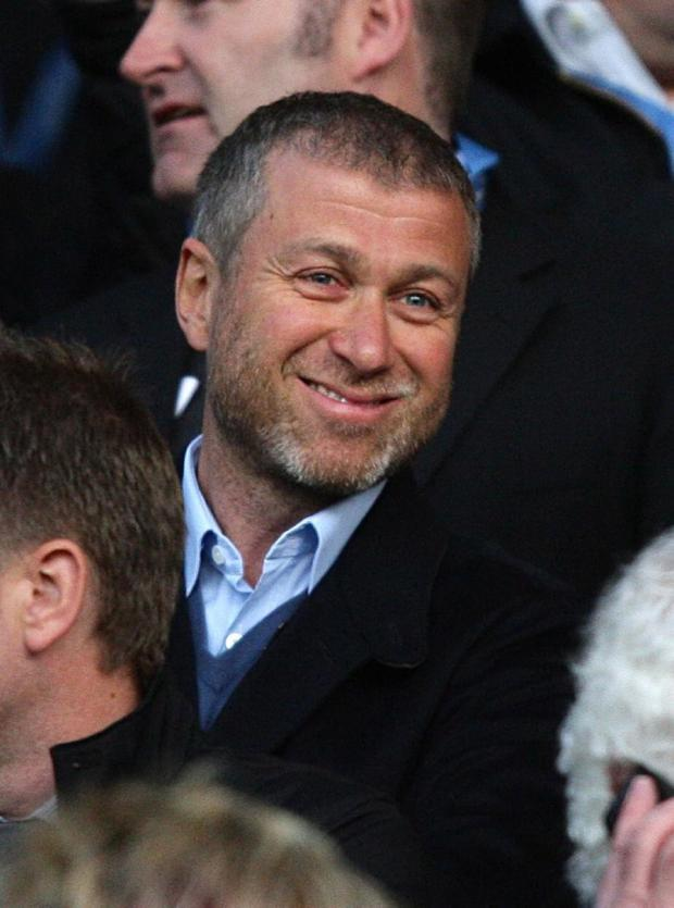 Chelsea owner Roman Abramovich watches his side's Champions League quarter-final second leg game from the directors' box at Old Trafford. Chelsea's defeat by Manchester United has fuelled speculation on the future of manager Carlo Ancelotti