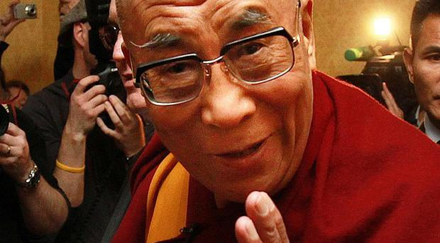 The Dalai Lama received a stranding ovation from a 2,000-strong crowd at the Citywest Hotel in Dublin