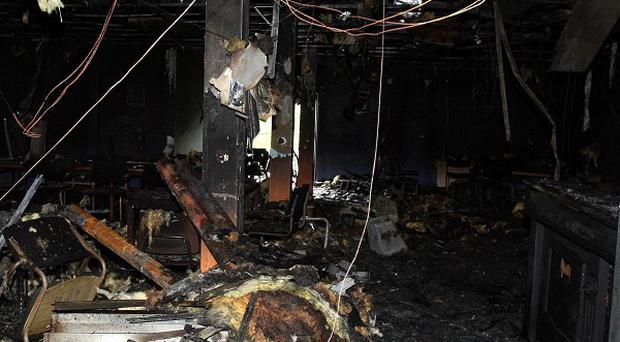 The aftermath of a fire in the Orange Hall, on the Crumlin Road in Belfast