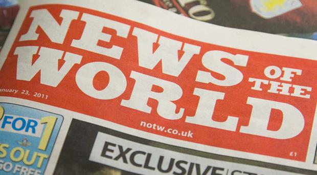 A senior reporter at the News of the World has been arrested by detectives investigating the phone-hacking scandal