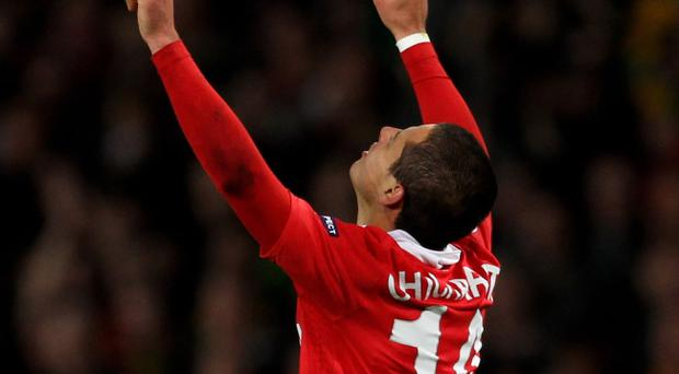 Javier Hernandez of Manchester United celebrates scoring the opening goal during the UEFA Champions League Quarter Final second leg match between Manchester United and Chelsea at Old Trafford on Tuesday night.