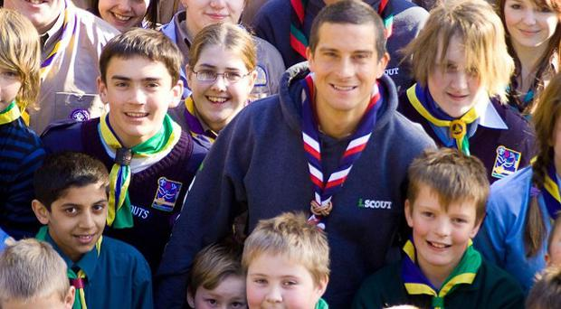 TV adventurer and Chief Scout Bear Grylls with young Scouts