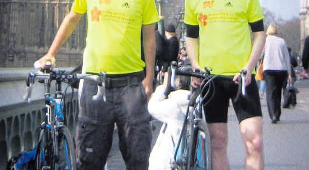 Gareth Crockett (left) and Jeremy Davison on Tower Bridge, London, prior to their charity run