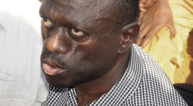 Uganda opposition leader Kiiza Besigye at a protest against high fuel prices prior to being arrested (AP/Ronald Kabuubi)